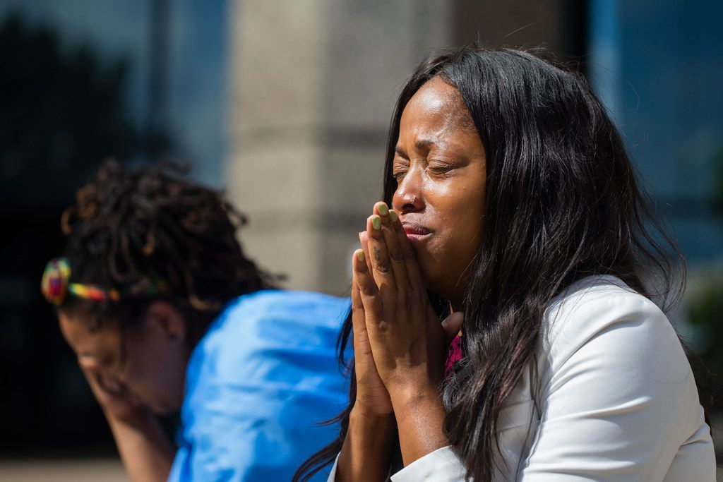 Tamara Neil is overcome with emotions as she and Safiya Paul of St. Lucia talk after Amber Guyger was convicted of murder Tuesday for killing Botham Jean.