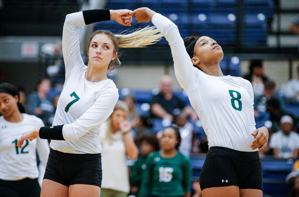 Mansfield Lake Ridge senior Logyn Hinds (7) and junior Lyric Stewart (8) participate in a prematch ritual during a high school volleyball game against North Mesquite at Mansfield Lake Ridge High school in Mansfield, Tuesday, August 27, 2019. Lake Ridge won in three sets. (Brandon Wade/Special Contributor)