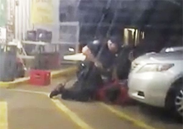 A screen grab from a cellphone video obtained by The Advocate reportedly shows a Baton Rouge police officer fatally shooting a man outside a store.