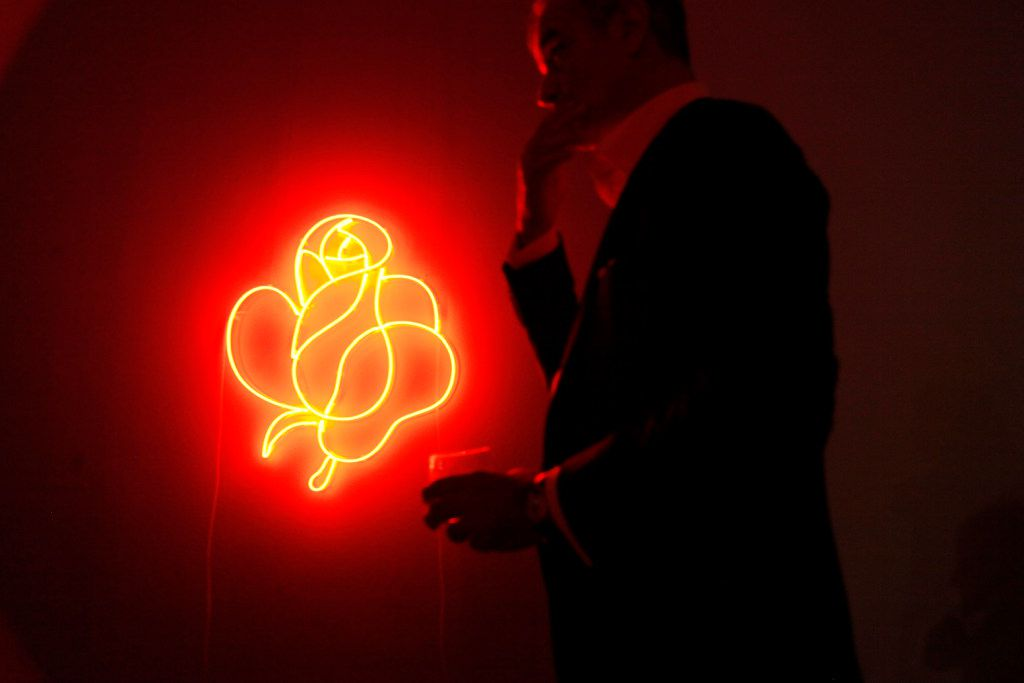 A man holding a cocktail walks passed a neon light untitled (Takashimaya Rose - Red) by Cerith Wyn Evans, during the MTV Re:Define gala at the Dallas Contemporary, Friday evening, March 24, 2017 in Dallas. Ben Torres/Special Contributor