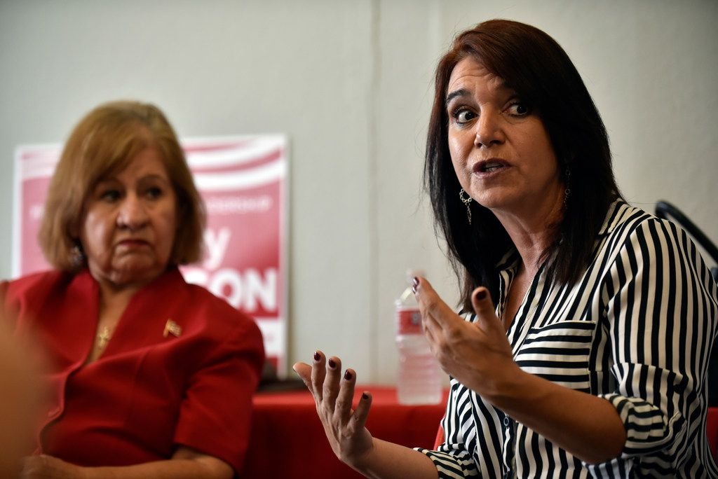 Nancy Richer (right), Hispanic engagement director for the Dallas County Republican Party, speaks with colleagues during an interview at the office of Rep. Rodney Anderson in Irving in August.
