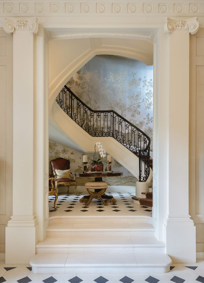 Gracie wallpaper frames the three-story grand staircase of the Bobby Haas home in Preston Hollow.