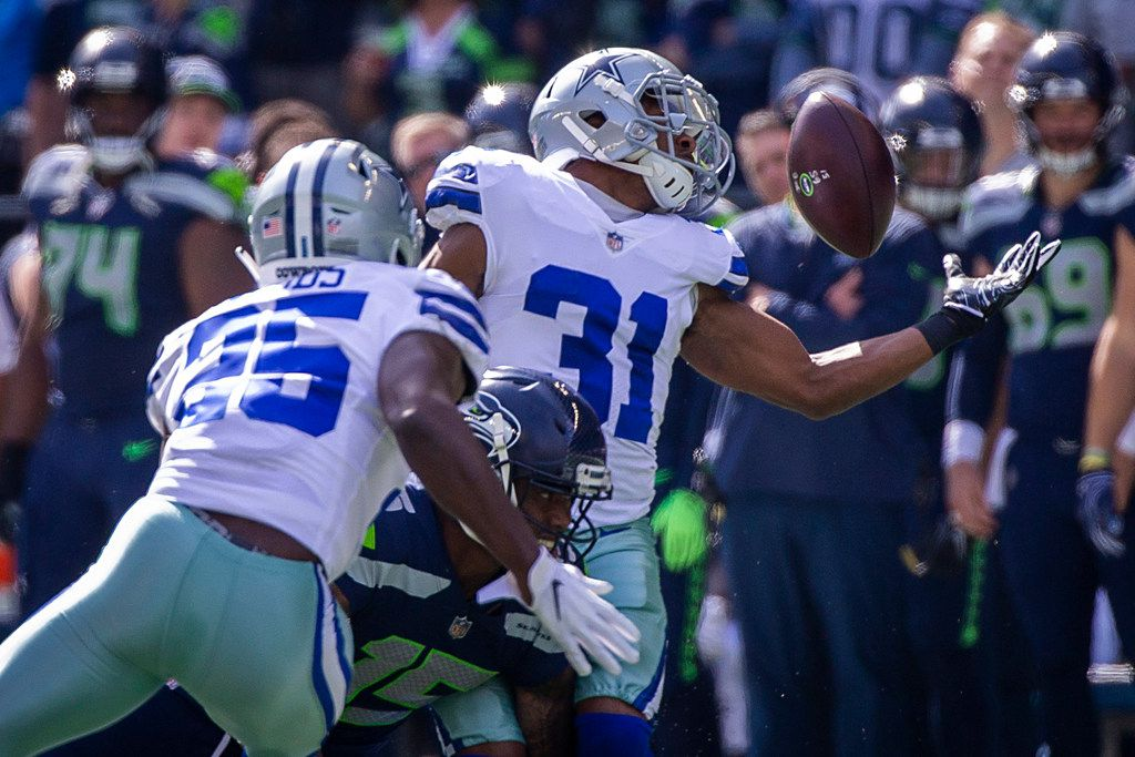 FILE - Cowboys cornerback Byron Jones (31) nearly intercepts a pass intended for Seattle Seahawks wide receiver Brandon Marshall (15) during the first half of an NFL football game at CenturyLink Field on Sunday, Sept. 23, 2018, in Seattle. (Smiley N. Pool/The Dallas Morning News)