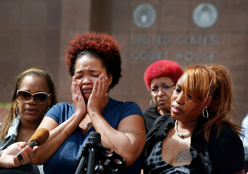 Shaquna Persley, mother of slain 13 yr-old Shavon Randle, is overcome with emotion as she speaks about the 18-year sentence of Darrius Fields outside the Earle Cabell Federal Building in Dallas, Friday, May 17, 2019. She is joined by Jessie Randle (right), great niece of Shavon. Fields was given the sentence by Judge Barbara Lynn on firearms charges, including the illegal possession of a weapon. He's believed to be connected to the death of Randle.