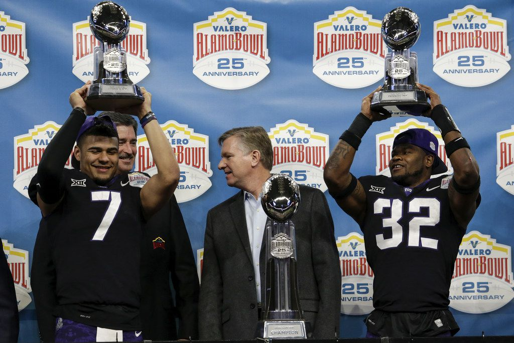 SAN ANTONIO, TX - DECEMBER 28:  Kenny Hill #7 of the TCU Horned Frogs and Travin Howard #32 hold player of the game trophies for offence and defense after the Valero Alamo Bowl game against the Stanford Cardinal at the Alamodome on December 28, 2017 in San Antonio, Texas.  (Photo by Tim Warner/Getty Images)