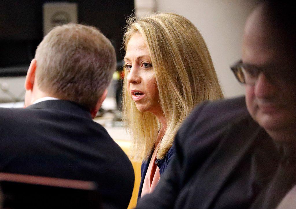 Amber Guyger looks toward her attorney Wednesday before testimony resumed in her murder trial. (Tom Fox/Staff Photographer)