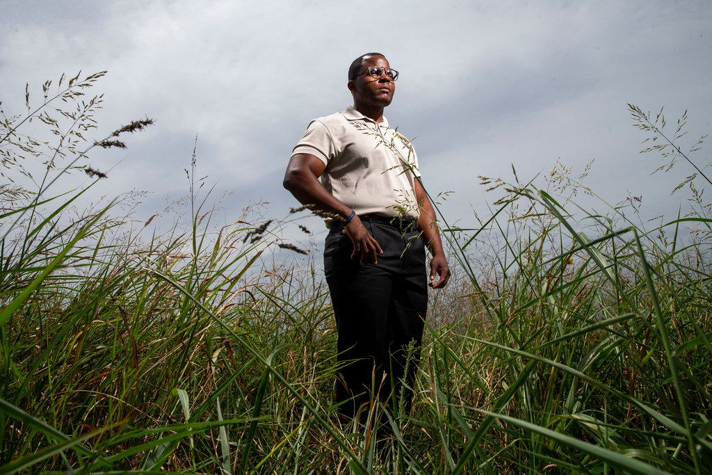 Sr. Cpl .Larry Moody poses for a portrait in field near his Forney  home on Aug. 27.. City officials have negotiated a contract to help increase pay for police officers.