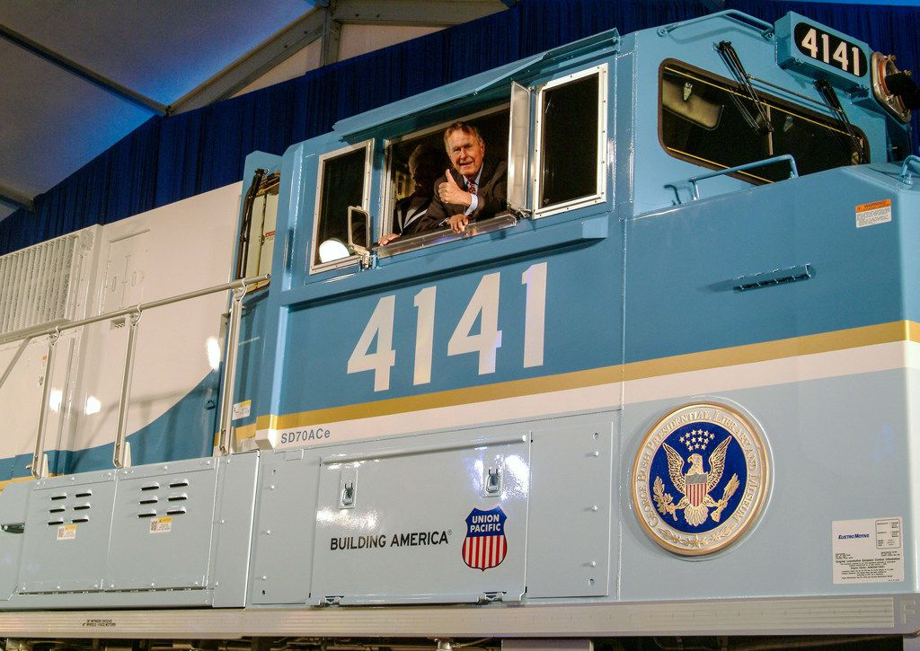 George H.W. Bush looks out of the cab of Union Pacific locomotive 4141 at its 2005 unveiling in College Station, Texas.