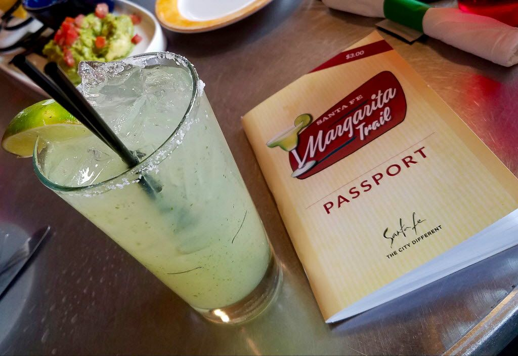 Coyote Cantina, the rooftop bar of Coyote Cafe in Santa Fe, makes a tall margarita spiced up with green chile-infused tequila. It added a stamp to our passports for the Margarita Trail.