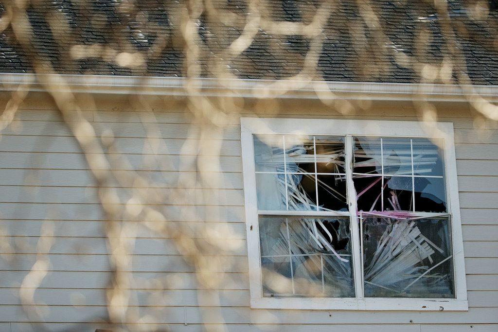 A broken window is seen as authorities work at a scene where they suspect Brandon McCall shot an officer the day before at the Breckinridge Point apartment complex in Richardson, Texas Thursday, February 8, 2018.