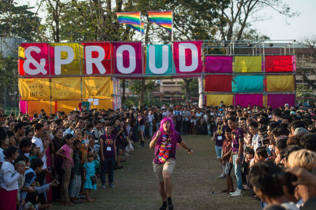 """This photo taken on January 28, 2018 shows a participant (C) running in a high-heel game during the """"&Proud"""" LGBT festival"""" in Yangon. Races, games, music and fun were just some of the highlights of the """"&Proud"""" LGBT festival, which took place in a Yangon public park for the first time at the weekend in a country where same-sex relations are still officially illegal. / AFP PHOTO / YE AUNG THUYE AUNG THU/AFP/Getty Images"""