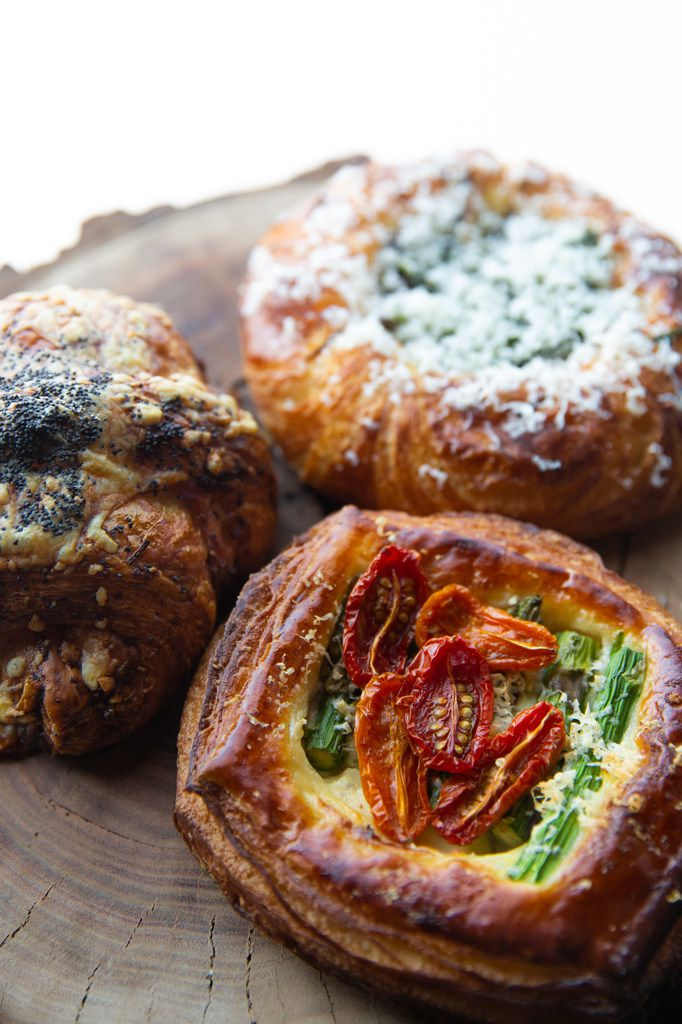 A ham and Gruyere croissant, an asparagus and tomato Danish with roasted garlic-pecorino bechamel, and a roasted mushroom and goat cheese Danish with kale pesto — all cooked by Matt Bresnan.