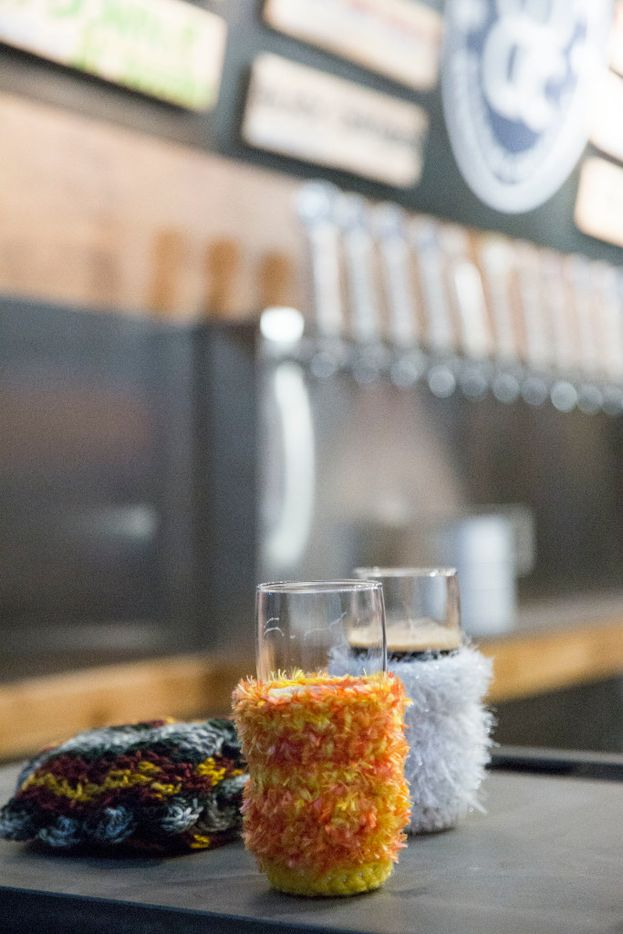 A customer'€™s crocheted koozies cover beer at the opening of Peticolas Brewing Company in Dallas, Texas, on Thursday, January 12, 2017.