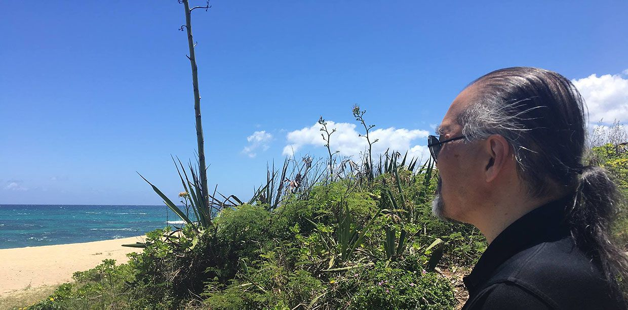 Dallas Morning News editorial writer and columnist Mike Hashimoto, the husband of columnist Jacquielynn Floyd, on the north shore of Oahu earlier this year.