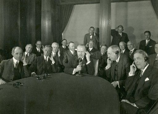 In this photo released by the American Telephone and Telegraph Company, AT&T President Walter S. Gifford, center, places the first trans-Atlantic telephone call from New York to London on Jan. 7, 1927. (AP Photo/ Courtesy of AT&T Archives and History Center, HO)