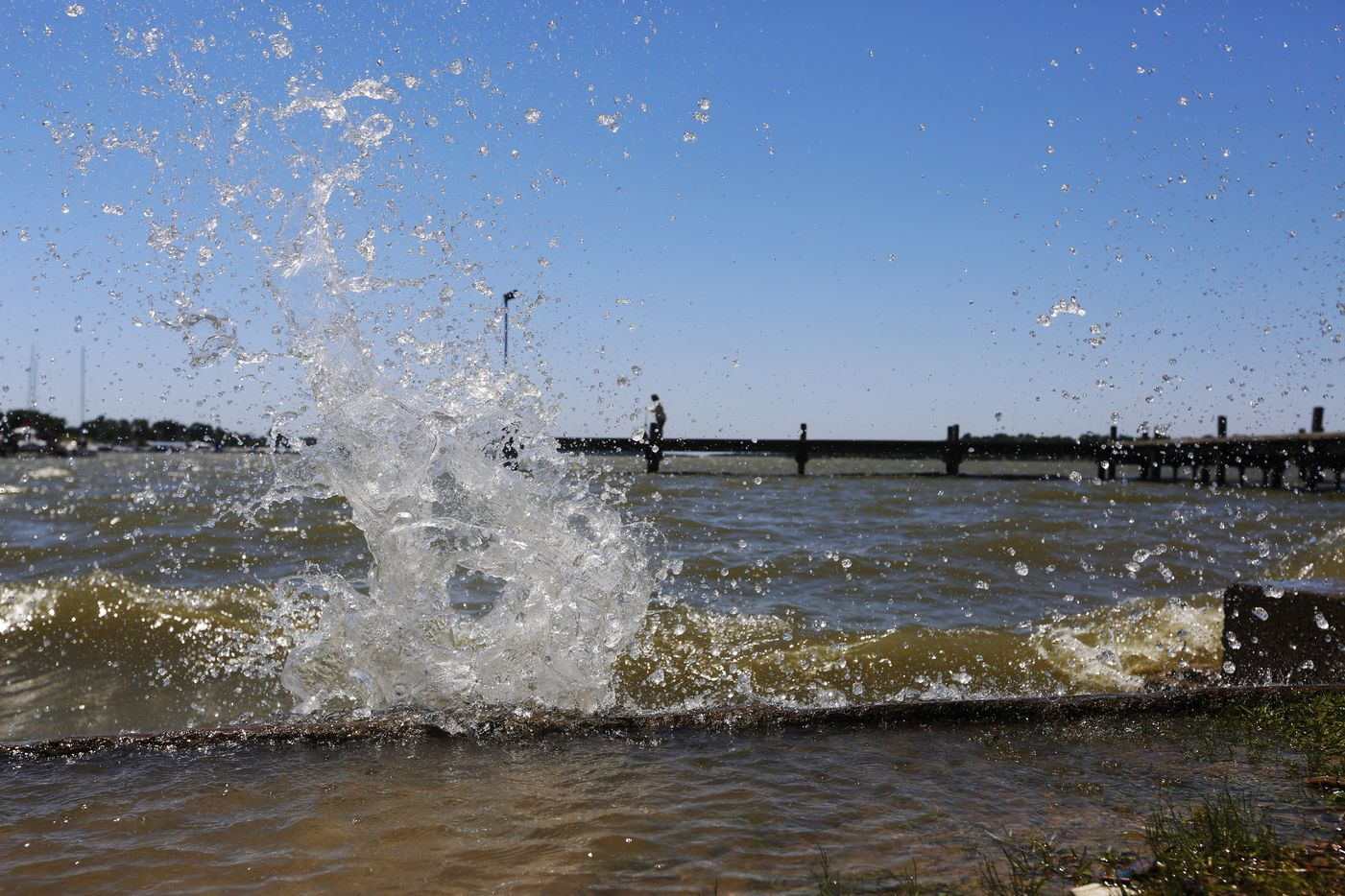Strong winds blow water against the shore of White Rock Lake in May 2017.