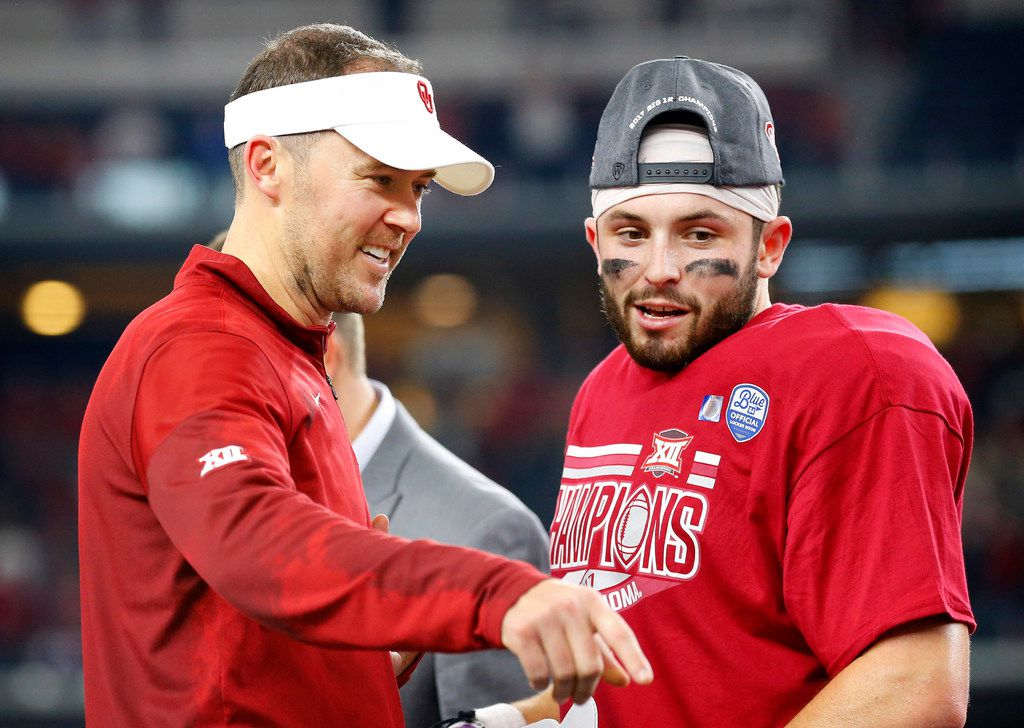 Oklahoma Sooners head coach Lincoln Riley and quarterback Baker Mayfield (6) celebrate their Big XII Championship win over the TCU Horned Frogs at AT&T Stadium in Arlington, Texas, Saturday, December 2, 2017. The Sooners won, 41-17. (Tom Fox/The Dallas Morning News)