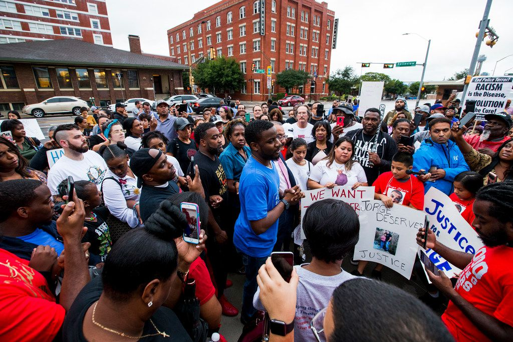 Dominique Alexander talks to protesters during a protest over the shooting of Botham Shem Jean on Sept. 10, 2018 at the Jack Evans Police Headquarters in Dallas.