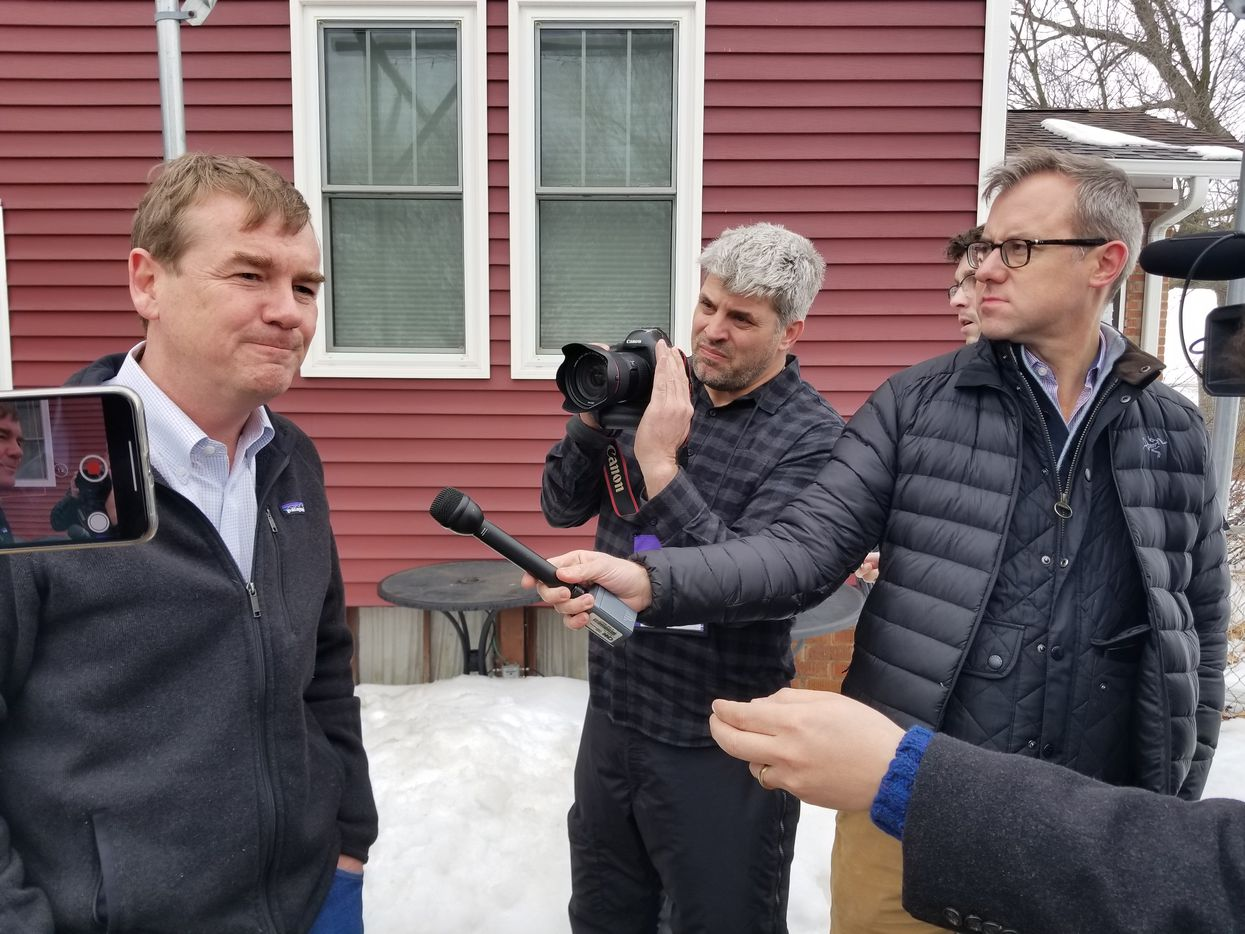 Sen. Michael Bennet of Colorado speaks with reporters in Polk City, Iowa., after meeting with farmers on Feb. 23., 2019, as he weighs a bid for the Democratic presidential nomination.