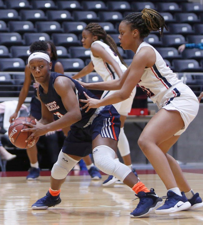 Sachse guard Jayla Brooks (13) looks to drive around the defense of Allen forward Tyler Jackson (22) during second half action. The two teams played in the Class 6A Region ll quarterfinal girls playoff basketball game at the Curtis Culwell Center in Garland on February 19, 2019. (Steve Hamm/ Special Contributor)