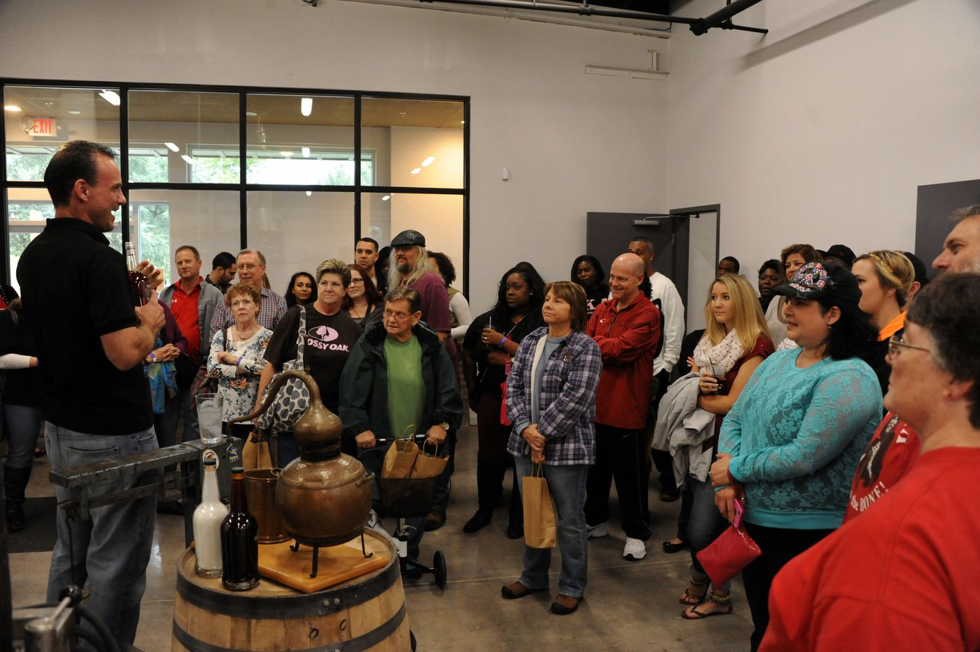 Tour guides welcome guests at Witherspoon Distillery in Lewisville, TX on October 24, 2015.