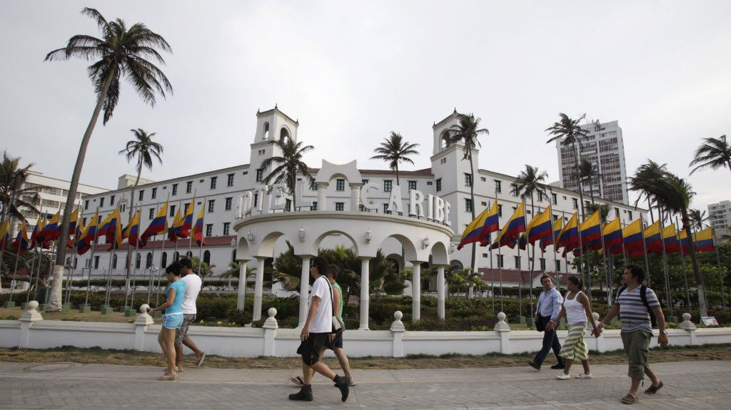 People walk past Hotel El Caribe in Cartagena, Colombia, Saturday April 14, 2012.