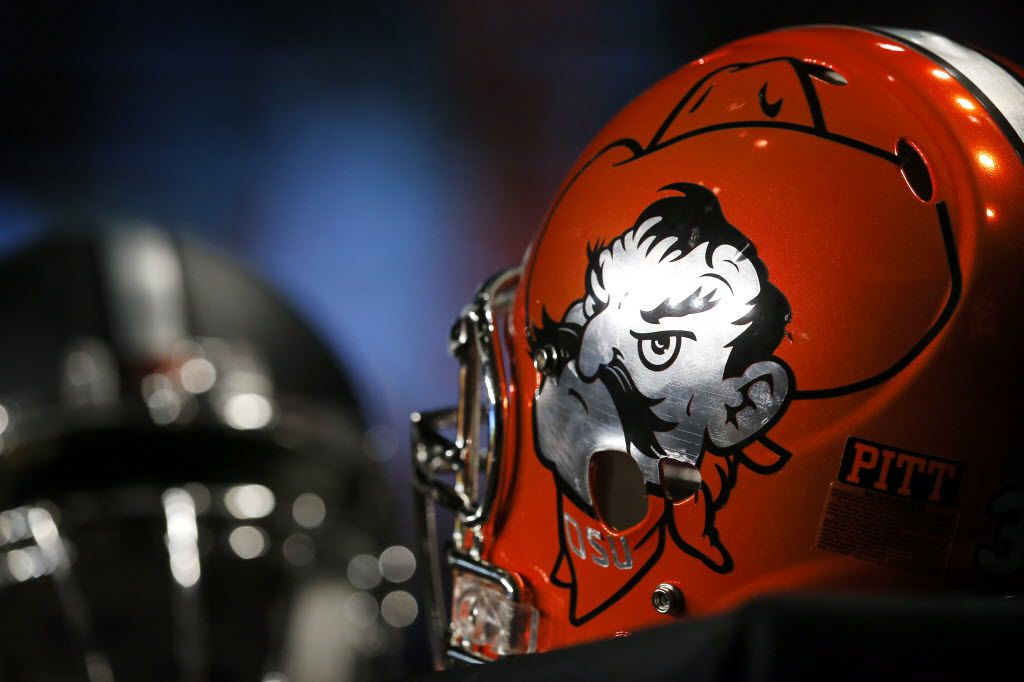 An Oklahoma State helmet sports the Cowboys mascot during a Q&A media session during the Big 12 Conference Football Media Days at the Omni Dallas, July 16, 2016. (Tom Fox/The Dallas Morning News)