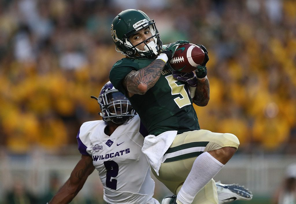 WACO, TX - SEPTEMBER 01:  Jalen Hurd #5 of the Baylor Bears makes a touchdown pass reception against Brandon Richmond #2 of the Abilene Christian Wildcats at McLane Stadium on September 1, 2018 in Waco, Texas.  (Photo by Ronald Martinez/Getty Images) ORG XMIT: 775197914