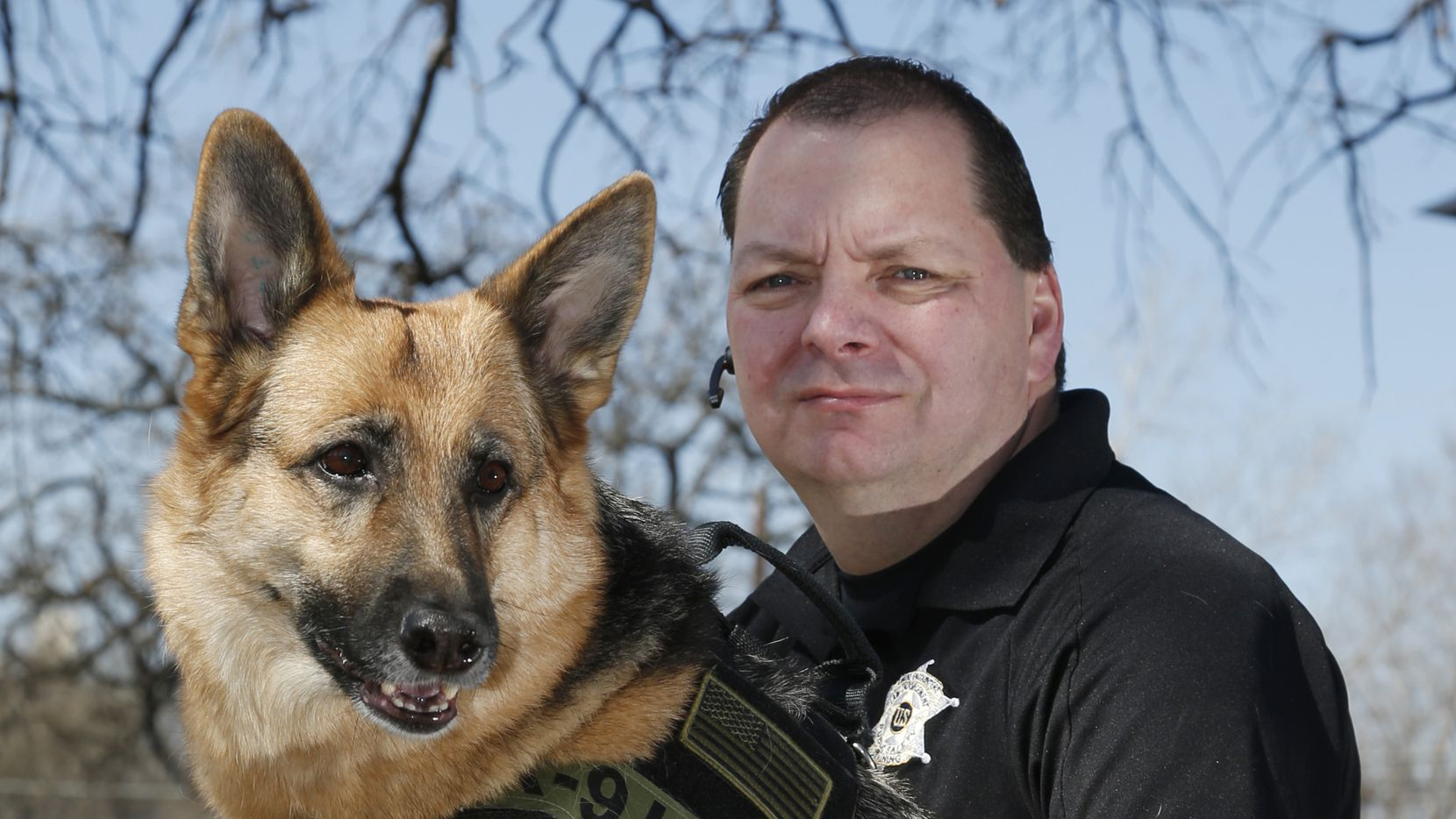 Jim Osorio, of Canine Encounters Law Enforcement Training, with his German Shepherd, Coral, pictured in Arlington.