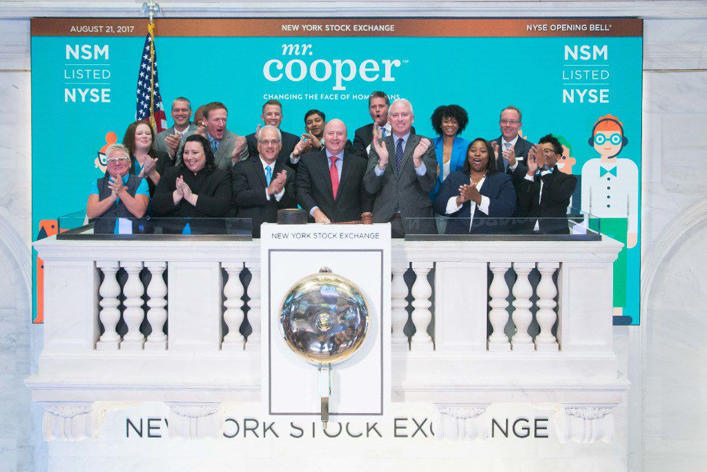 Jay Bray (center), chairman and CEO of Nationstar, and other company executives after ringing the opening bell at NYSE on Aug. 21, 2017.