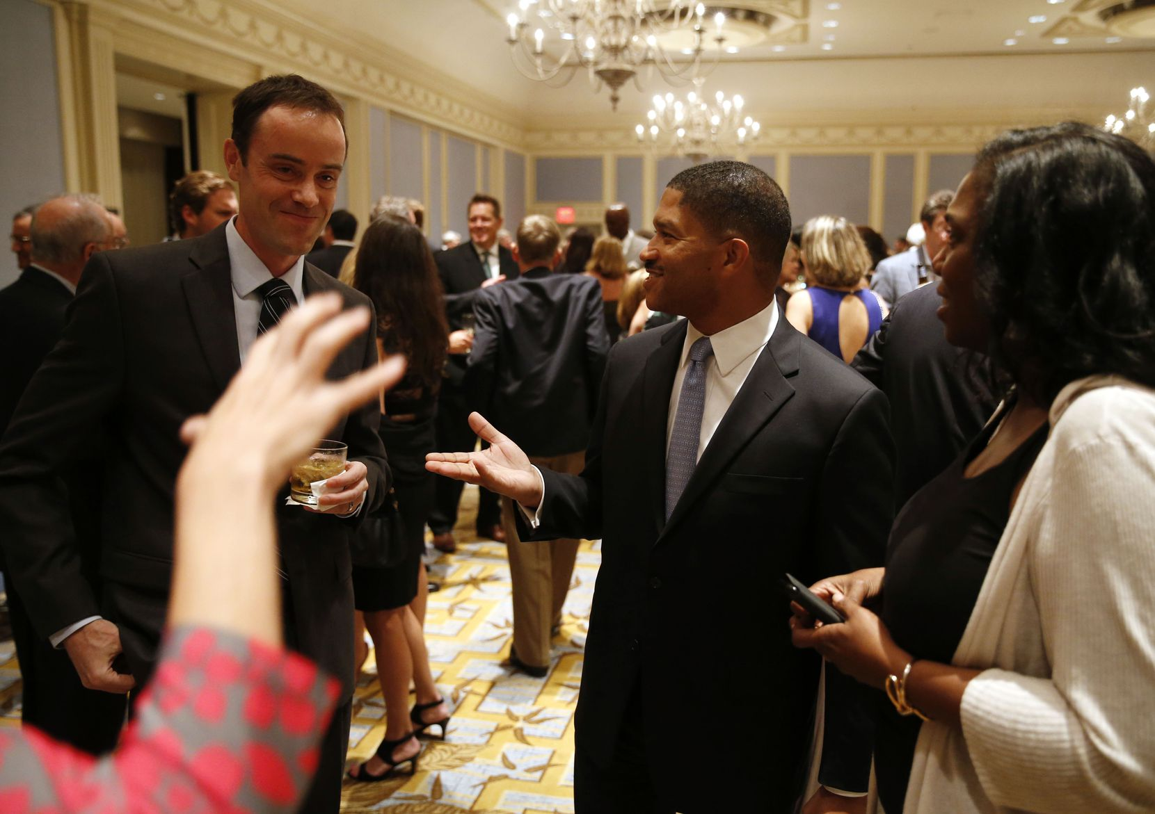 James and Frances Waters greet others before the start of the 33rd annual H. Neil Mallon award dinner at the Hilton Anatole. (Vernon Bryant/Staff Photographer)