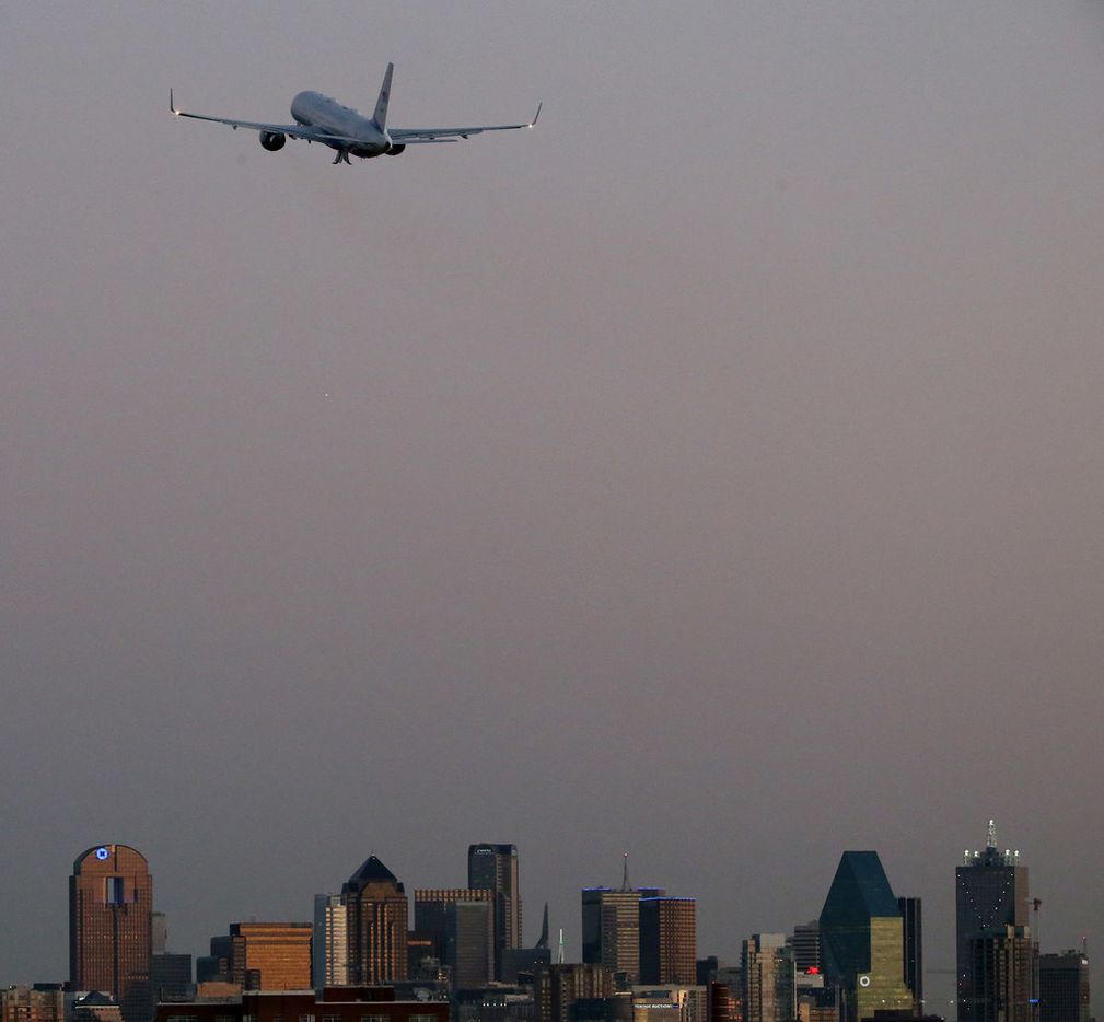 With the skyline of downtown Dallas in the background, President Donald Trump departs on Air Force One from Love Field after a visit that included a stop at the Belo Mansion and a hurricane recovery briefing in Dallas Wednesday October 25, 2017. President Trump participated in a hurricane recovery briefing, a Republican National Committee roundtable and gave remarks at a reception. (Andy Jacobsohn/The Dallas Morning News)