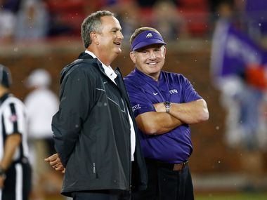 TCU coach Gary Patterson, right, and SMU coach Sonny Dykes, left, talk before an NCAA college football game Friday, Sept. 7, 2018, in Dallas. (AP Photo/Jim Cowsert)