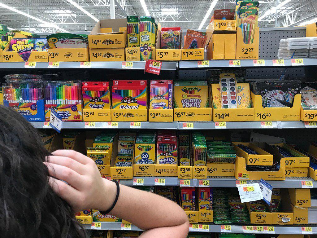 Morning News writer Lauren Fox hunts for school supplies at Walmart in Dallas on Wednesday, Aug. 10.