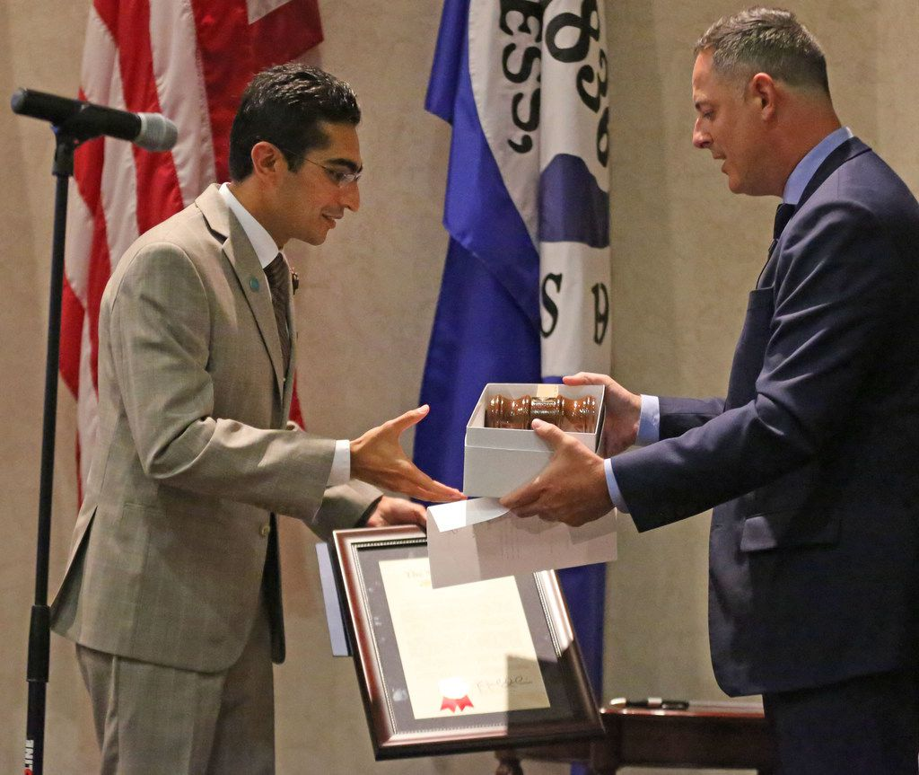 State Rep. Rafael Anchia, D-Dallas, presented Salman Bhojani a gavel after Bhojani's swearing-in ceremony last month.