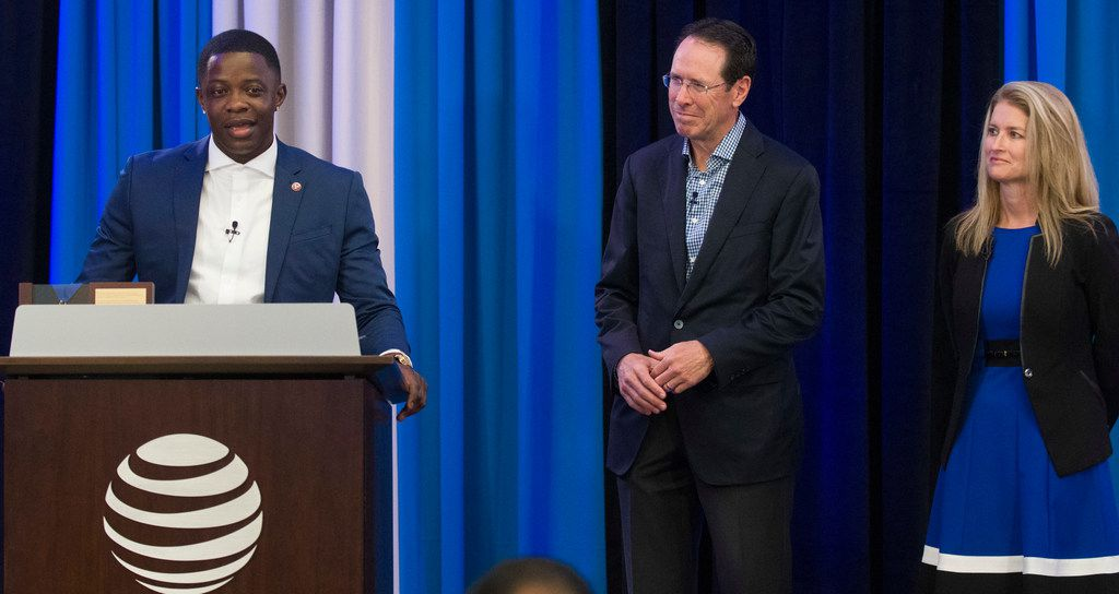 AT&T employee James Shaw Jr., left, joined by AT&T CEO Randall Stephenson, and AT&T President of Technology and Operations Melissa Arnoldi, talks about his role in subduing a gunman at a Waffle House near Nashville, Tennessee where four people were killed on April 22, 2018. Shaw is one of two AT&T employees who received the company's Vail Award on July 23, 2018 at AT&T corporate headquarters in Dallas, Texas.