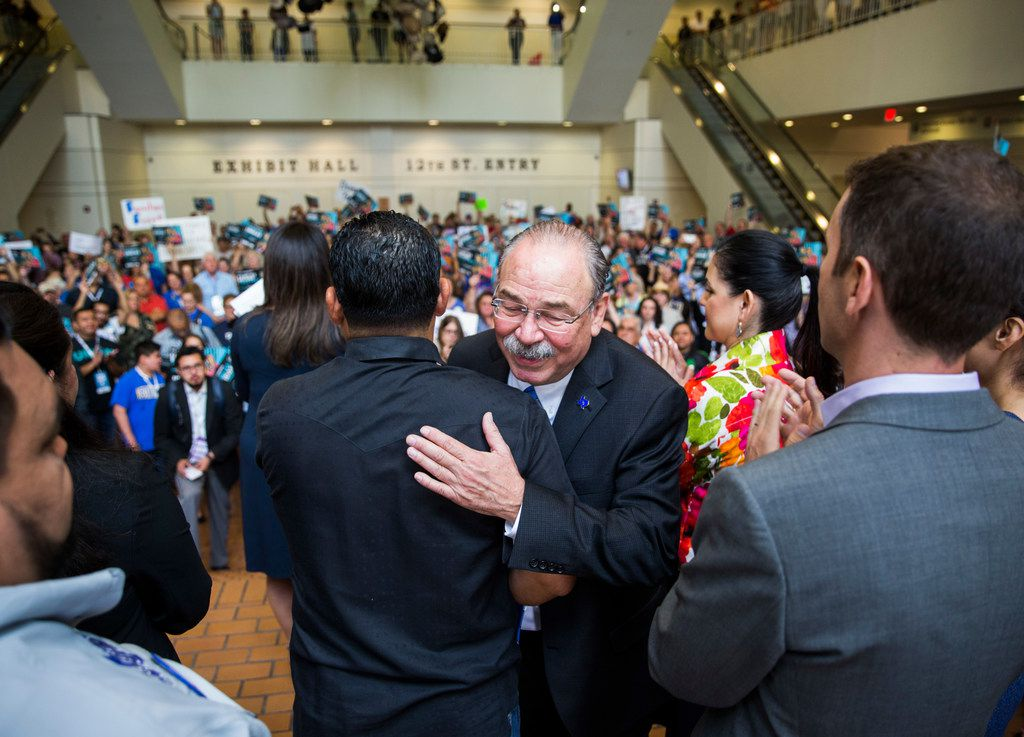 Gilberto Hinojosa gets a hug from a supporter after speaking during a Families First Rally at the Texas Democratic Convention on Saturday, June 23, 2018 at the Fort Worth Convention Center in Fort Worth. (Ashley Landis/The Dallas Morning News)