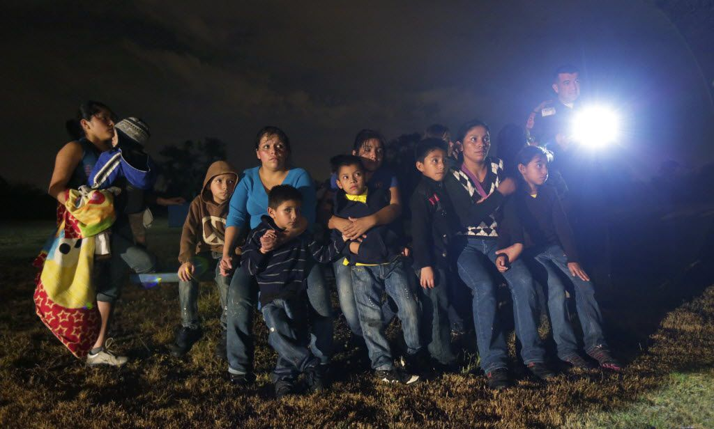 FILE - This June 25, 2014 file photo, shows a group of immigrants from Honduras and El Salvador who crossed the U.S.-Mexico border illegally as they are stopped in Granjeno, Texas. Illegal crossings along the Rio Grande have slowed dramatically since an overwhelming surge of immigrants had state and federal agents scrambling to secure the border earlier this year. But Texas leaders don't want their ground troops to leave just yet. An $86 million proposal would keep extra state troopers and the National Guard in South Texas through next August, prompting criticisms from local law enforcement who say the money would be better spent elsewhere.  (AP Photo/Eric Gay, File) 03192015xNEWS