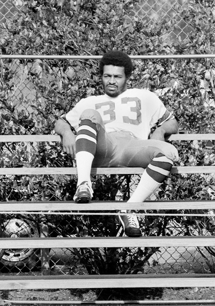 Dallas Cowboys running back Duane Thomas sits along on bleachers at training camp in New Orleans. Thomas refused to pose for pictures or interviews by sports writers.