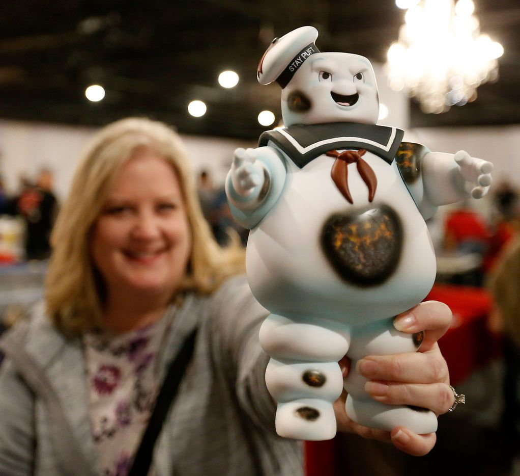 Tara Clever pose for a photograph with Ghostbusters Stay Puft Marshmallow Man she bought at North Dallas Toy Show at Dallas Event Center in Farmers Branch, Texas, Saturday, Jan. 6, 2018.