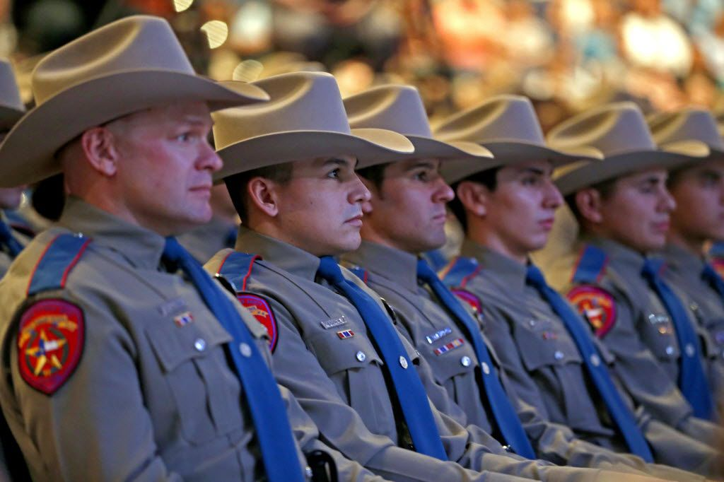 From left, John Allen, Miguel Alvarez, Alex Amador, Osvaldo Anzaldua and David Arias attend the 155th trooper training class graduation ceremony at Shoreline Church on Friday, June 17, 2016, in Austin, Texas. Texas Department of Public Safety has the highest number of Hispanic trooper graduates at any time over the last decade and currently the classes of this year are about 40 percent Hispanic.