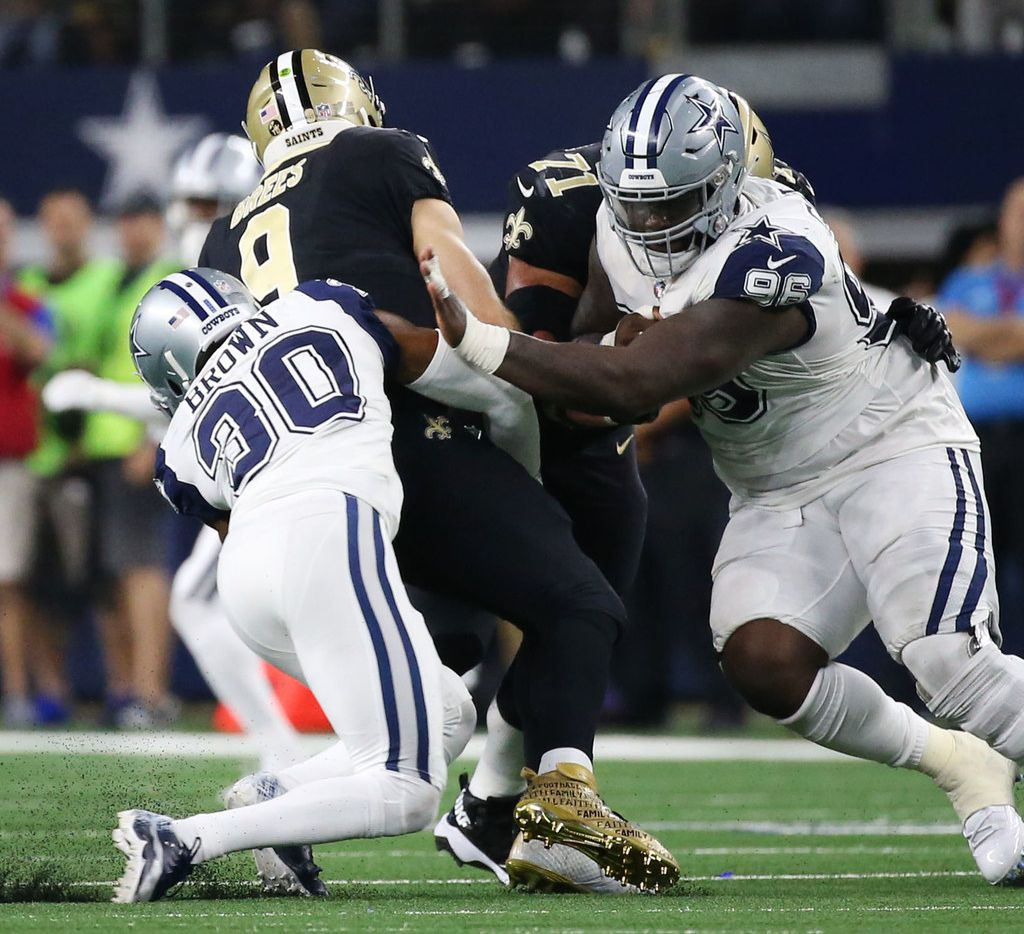 New Orleans Saints quarterback Drew Brees (9) is sacked by Dallas Cowboys cornerback Anthony Brown (30) in the fourth period at AT&T Stadium in Arlington, Texas on Thursday, Nov. 29, 2018. The Dallas Cowboys beat the New Orleans Saints 13-10. (Rose Baca/The Dallas Morning News)