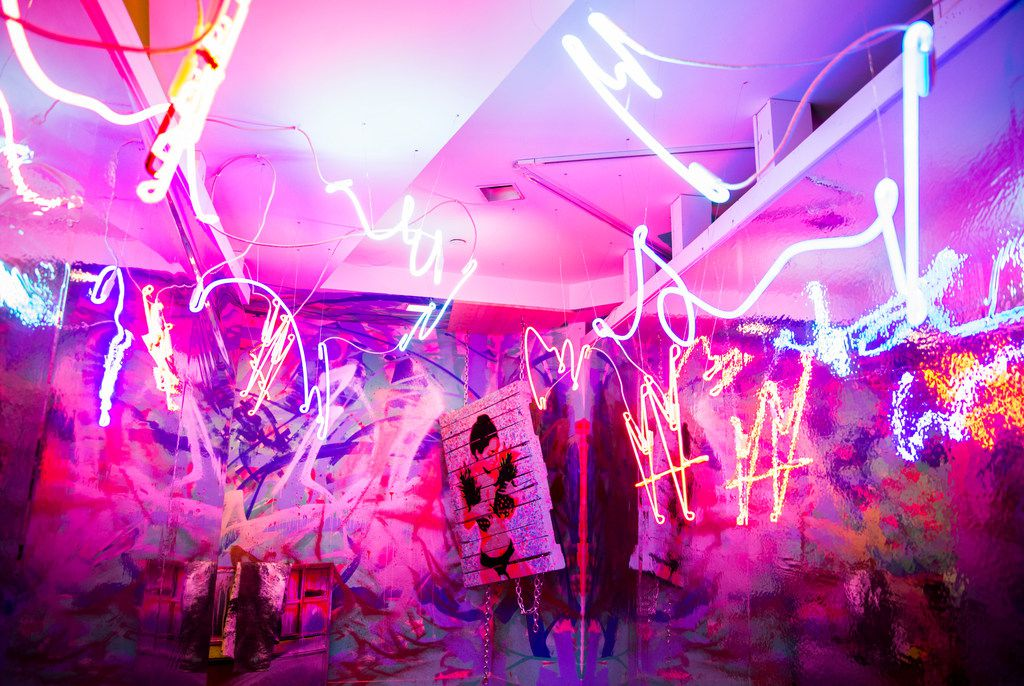 Neon and bright spray paint are the hallmarks of many of the rooms at Psychedelic Robot, a new 'immersive art' exhibit at the Crescent in Dallas.