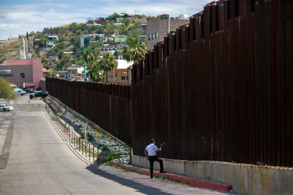 In this April 1, 2017, photo, a man in Nogales, Ariz., talks to his daughter and her mother who are standing on the other side of the border fence in Nogales, Mexico. Homeland Security Secretary John Kelly says arrests of people entering the United States illegally across the Mexican border plummeted in March. That's a signal that fewer people are trying to sneak into the U.S. (AP Photo/Rodrigo Abd)