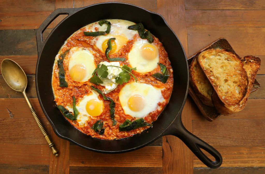 Eggs poached in spiced tomato-harissa sauce