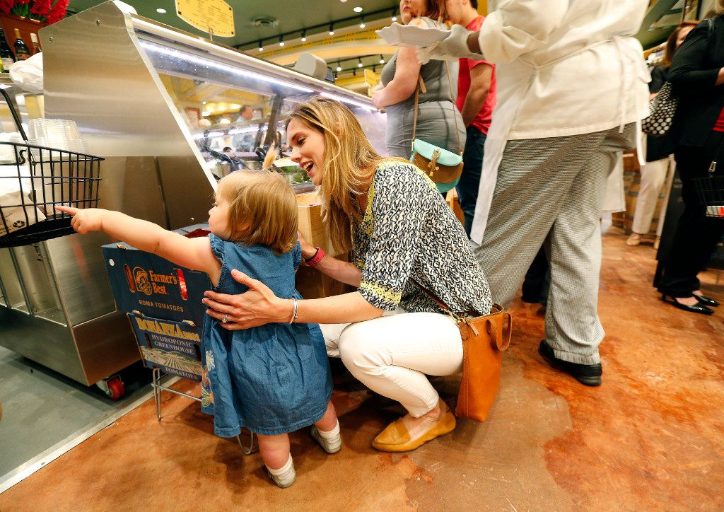 Avery Elander and her daughter Alice check out the fresh produce during VIP night at the new Eatzi's Market & Bakery at University Park Village in Fort Worth.