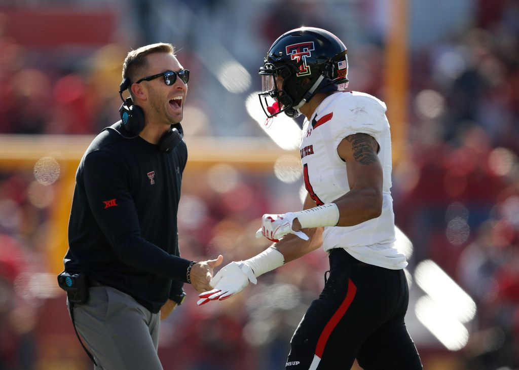 AMES, IA - OCTOBER 27: Head coach Kliff Kingsbury of the Texas Tech Red Raiders celebrates with wide receiver Antoine Wesley #4 of the Texas Tech Red Raiders after he pulled in a pass in the end zone to score a touchdown in the second half of play at Jack Trice Stadium on October 27, 2018 in Ames, Iowa. The Iowa State Cyclones won 40-31 over the Texas Tech Red Raiders. (Photo by David Purdy/Getty Images)