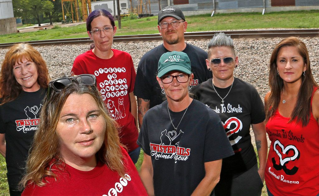 Mysti Boehler (second from left), the leader of Streets to Sheets, poses with members of her group and Twisted Tails Animal Rescue near the spot in Waxahachie where Hobo the dog was captured. Other members are Tammy Dupal (center-front) and (from left) Suzanne Hrabovski, Krystea Mathews, Andreas Dupal, Jennifer Harisis and Reyna Castillo.