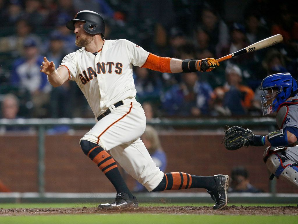 In this Tuesday, Sept. 12, 2017 file photo, San Francisco Giants' Hunter Pence hits a single to drive in a run against the Los Angeles Dodgers during the sixth inning of a baseball game in San Francisco. (AP Photo/Tony Avelar, File)