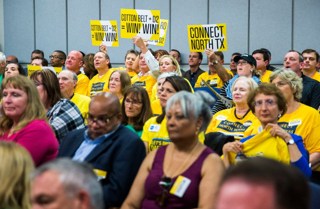 Cotton Belt supporters hold up signs as the board of the Dallas Area Rapid Transit voted to finance both the Cotton Belt and D2 subway plans for a rail corridor on Tuesday, October 25, 2016 at DART headquarters in Dallas. (Ashley Landis/The Dallas Morning News)